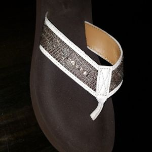 Brown coach flip flops